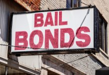 Bail Bonds sign chained to a building